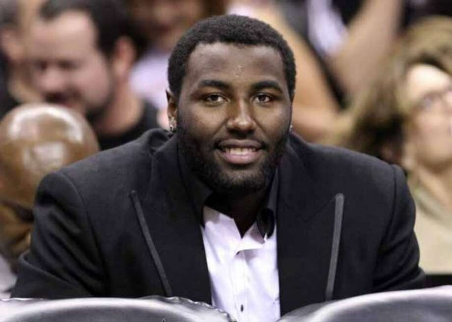 FOR SPORTS - Spurs' DeJuan Blair sits on the bench during first half action against the Warriors Monday March 21, 2011 at the AT&T Center.  (PHOTO BY EDWARD A. ORNELAS/eaornelas@express-news.net) (EDWARD A. ORNELAS / SAN ANTONIO EXPRESS-NEWS)