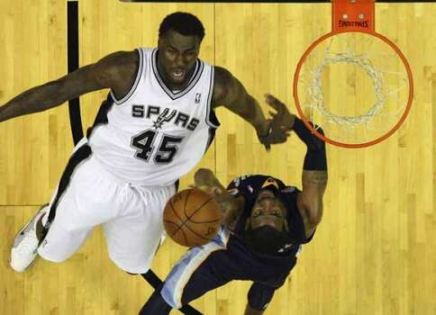 Memphis Grizzlies' Mike Conley (right) drives to the basket against Spurs' DeJuan Blair (45) in the first round of the Western Conference playoffs at the AT&T Center on Wednesday, April 20, 2010. Spurs won 98-87. Kin Man Hui/kmhui@express-news.net (KIN MAN HUI / SAN ANTONIO EXPRESS-NEWS)