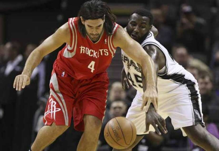 SPURS -- San Antonio Spurs DeJuan Blair steals the ball from Houston Rockets Luis Scola during the first half an NBA pre-season game at the AT&T Center in San Antonio, Wednesday, Dec. 21, 2011. JERRY LARA/glara@express-news.net (San Antonio Express-News)