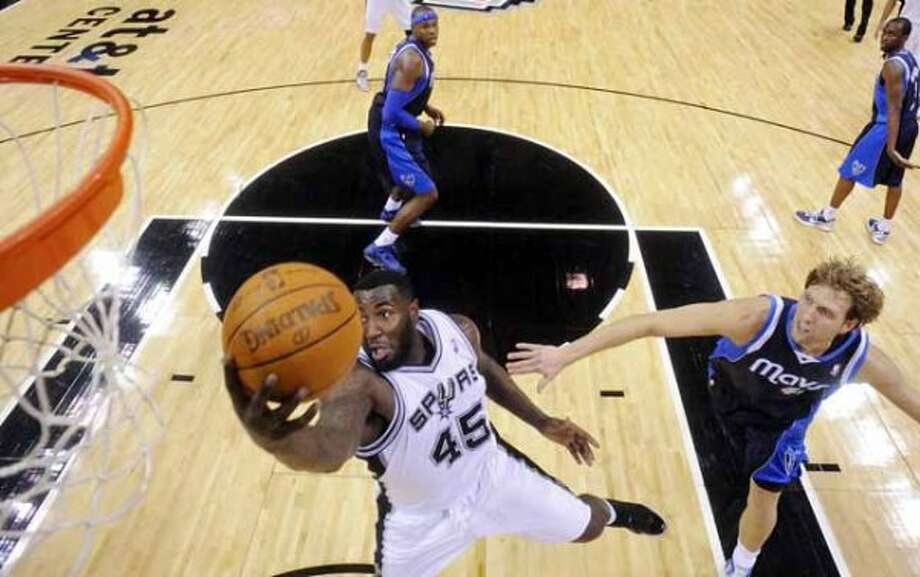 FOR SPORTS - San Antonio Spurs' DeJuan Blair goes up for a rebound around Dallas Mavericks' Dirk Nowitzki during second half action Thursday Jan. 5, 2012 at the AT&T Center.  The Spurs won 93-71.  (PHOTO BY EDWARD A. ORNELAS/eaornelas@express-news.net) (SAN ANTONIO EXPRESS-NEWS)