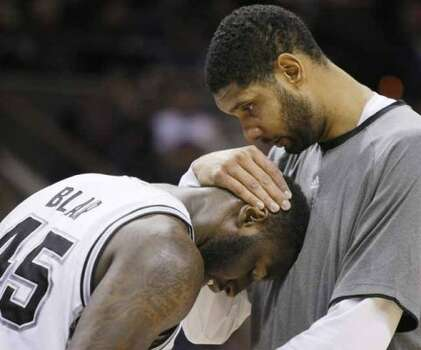 San Antonio Spurs' Tim Duncan, right, congratulates Spurs' DeJuan Blair on a successful play during the second half of an NBA basketball game against the Atlanta Hawks, Wednesday, Jan. 25, 2012, at the AT&T Center in San Antonio. San Antonio won 105-83. (AP Photo/Darren Abate) (AP)