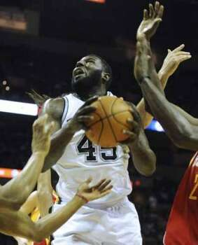 DeJuan Blair of the San Antonio Spurs battles to keep control of the ball against the Houston Rockets during first-half NBA action at the AT&T Center on Wednesday, Feb. 1, 2012.  Billy Calzada / San Antonio Express-NewsHouston Rockets at San Antonio Spurs (San Antonio Express-News)