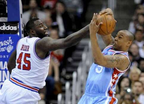 San Antonio Spurs forward DeJuan Blair (45) and Los Angeles Clippers forward Caron Butler (5) vie for a loose ball in the first half of an NBA basketball game Saturday, Feb. 18, 2012, in Los Angeles. (AP Photo/Gus Ruelas) (AP)