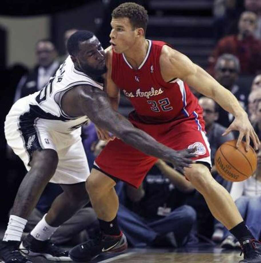 SPORTS   DeJuan Blair pressures Blake Griffin in the first quarter as the San Antonio Spurs host the Los Angeles Clippers at the AT&T Center  on March 9, 2012 Tom Reel/ San Antonio Express-News (San Antonio Express-News)