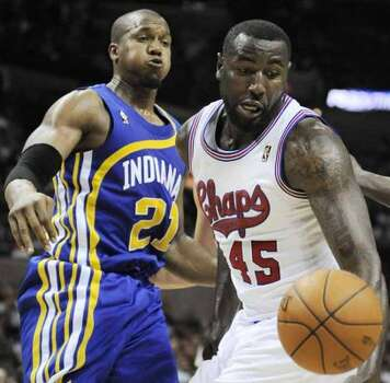 San Antonio Spurs' DeJuan Blair (45) and Indiana Pacers' David West chase a loose ball during the second half of an NBA basketball game on Saturday, March 31, 2012, in San Antonio. San Antonio won 112-103. (AP Photo/Darren Abate) (AP)