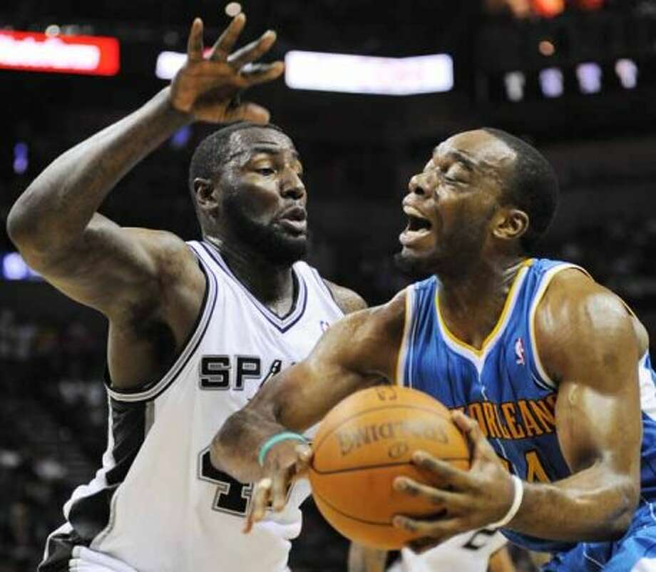 New Orleans Hornets' Carl Landry, right, is defended by San Antonio Spurs' DeJuan Blair during the second half of an NBA basketball game, Friday, April 6, 2012, in San Antonio. San Antonio won 128-103. (AP Photo/Darren Abate) (AP)