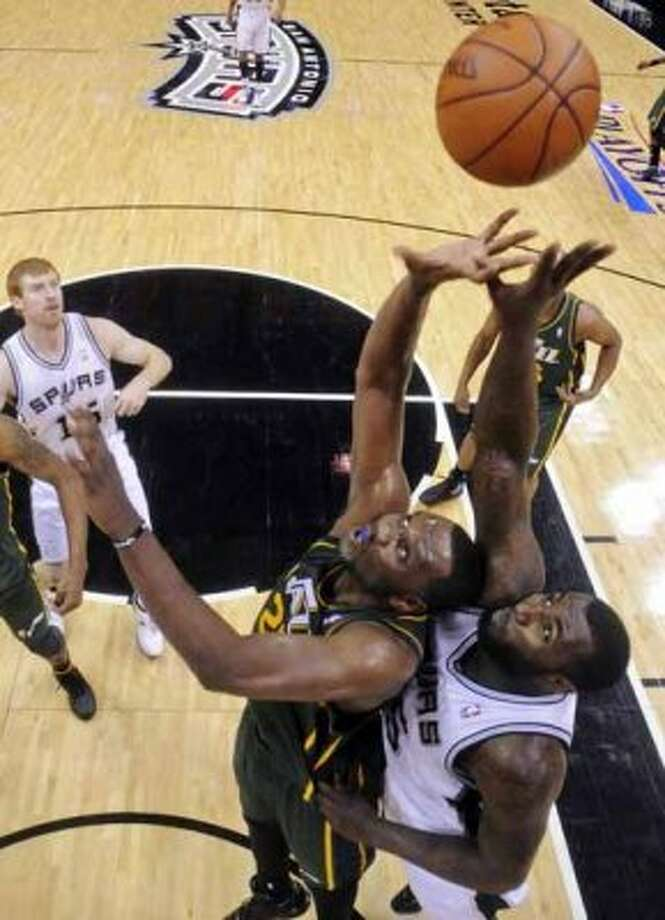 FOR SPORTS - Utah Jazz Al Jefferson and San Antonio Spurs DeJuan Blair grab for a rebound during first half action of Game 2 of the Western Conference first round Wednesday May 2, 2012 at the AT&T Center. The Spurs won 114-83.  (PHOTO BY EDWARD A. ORNELAS/SAN ANTONIO EXPRESS-NEWS) (SAN ANTONIO EXPRESS-NEWS)