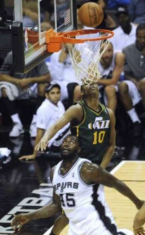 DeJuan Blair of the Spurs (25) and Alec Burks (10) of the Utah Jazz watch the ball as it drops in for two points for Blair during second-half NBA playoffs action at the AT&T Center on Wednesday, May 2, 2012.  Billy Calzada / San Antonio Express-News (San Antonio Express-News)