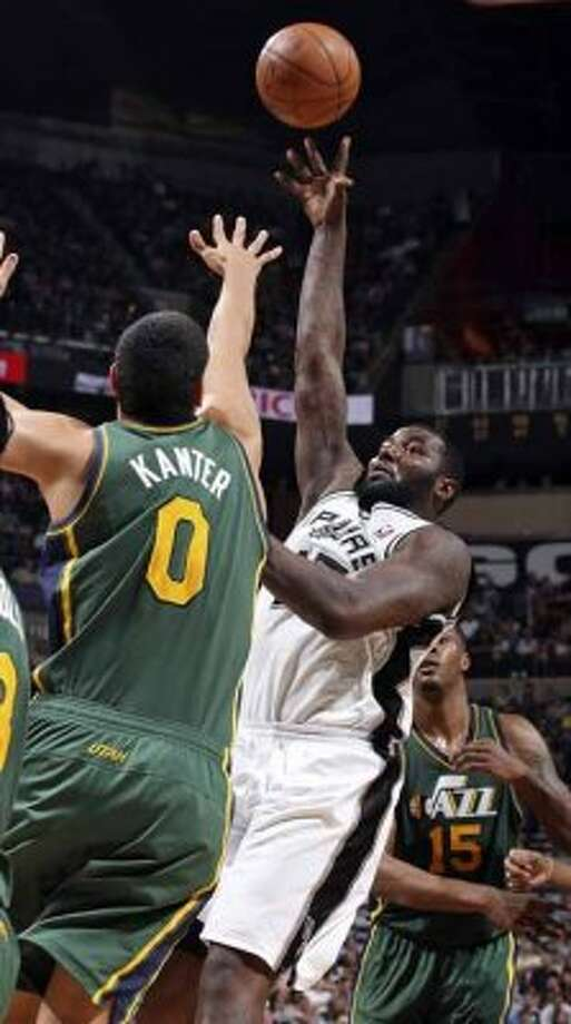 FOR SPORTS - San Antonio Spurs DeJuan Blair shoots over Utah Jazz Enes Kanter during second half action of Game 2 of the Western Conference first round Wednesday May 2, 2012 at the AT&T Center. The Spurs won 114-83.  (PHOTO BY EDWARD A. ORNELAS/SAN ANTONIO EXPRESS-NEWS) (SAN ANTONIO EXPRESS-NEWS)