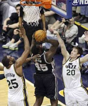 FOR SPORTS - San Antonio Spurs DeJuan Blair shoots between  Utah Jazz Al Jefferson and Gordon Hayward during first half action of Game 3 of the Western Conference first round Saturday May 5, 2012 at EnergySolutions Arena in Salt Lake City, Utah. (PHOTO BY EDWARD A. ORNELAS/SAN ANTONIO EXPRESS-NEWS) (SAN ANTONIO EXPRESS-NEWS)