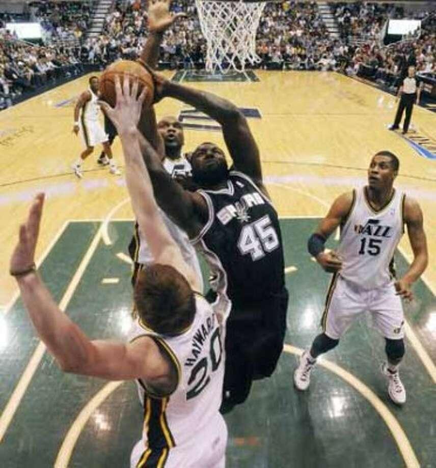 FOR SPORTS - San Antonio Spurs DeJuan Blair shoots between Utah Jazz Gordon Hayward and Utah Jazz Al Jefferson during first half action of Game 3 of the Western Conference first round Saturday May 5, 2012 at EnergySolutions Arena in Salt Lake City, Utah. (PHOTO BY EDWARD A. ORNELAS/SAN ANTONIO EXPRESS-NEWS) (SAN ANTONIO EXPRESS-NEWS)