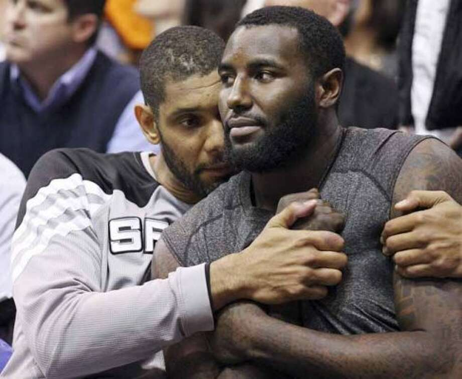 FOR SPORTS - Spurs' Tim Duncan hugs teammate DeJuan Blair during second half action of Game 4 of the Western Conference first round against the Jazz Monday May 7, 2012 at EnergySolutions Arena in Salt Lake City, Utah. The Spurs won 87-81. (PHOTO BY EDWARD A. ORNELAS/SAN ANTONIO EXPRESS-NEWS) (SAN ANTONIO EXPRESS-NEWS)