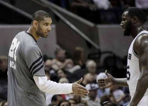 San Antonio Spurs' Tim Duncan, left, greets teammate DeJuan Blair, right, during the fourth quarter of Game 2 of a first-round NBA basketball playoff series against the Utah Jazz, Wednesday, May 2, 2012, in San Antonio. San Antonio won 114-83. (AP Photo/Eric Gay) (AP)