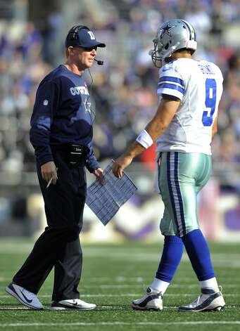 Dallas Cowboys head coach Jason Garrett, left, speaks with quarterback Tony Romo in the second half of an NFL football game against the Baltimore Ravens in Baltimore, Sunday, Oct. 14, 2012. (AP Photo/Gail Burton)
