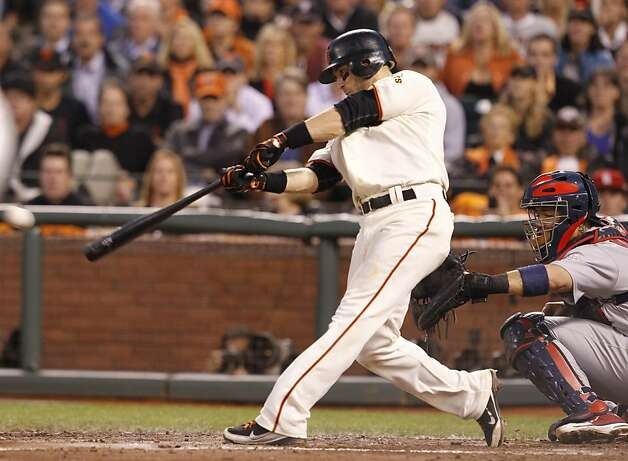 Giants' third baseman Marco Scutaro singles to center in the 4th to score 3 during game 2 of the NLCS on Monday, Oct. 15, 2012 at AT&T Park in San Francisco, Calif. Photo: Brant Ward, The Chronicle