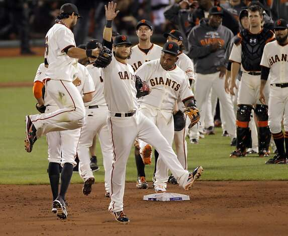 Angel Pagan jumps and high fives Brandon Crawford as the Giants celebrate after defeating the Cardinals. The San Francisco Giants played the St. Louis Cardinals in Game 2 of the National League Championship Series on Monday, October 15, 2012, at AT&T Park in San Francisco, Calif. The Giants defeated the Cardinals 7-1. Photo: Carlos Avila Gonzalez, The Chronicle