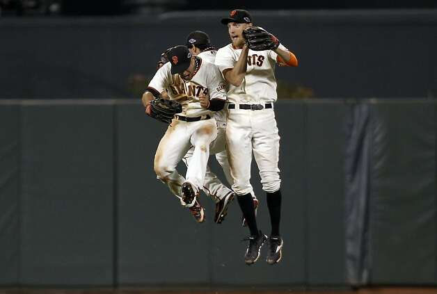 Gregor Blanco (left), Angel Pagan and Hunter Pence jump for joy after evening the NLCS. Photo: Michael Macor, The Chronicle / SF