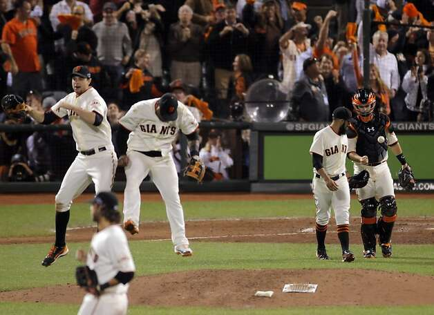 L-R, Brandon Belt and Pablo Sandoval celeberate as Sergio Romo and Buster Posey come to greet other players after the Giants defeated the Cardinals. The San Francisco Giants played the St. Louis Cardinals in Game 2 of the National League Championship Series on Monday, October 15, 2012, at AT&T Park in San Francisco, Calif. The Giants defeated the Cardinals 7-1. Photo: Carlos Avila Gonzalez, The Chronicle