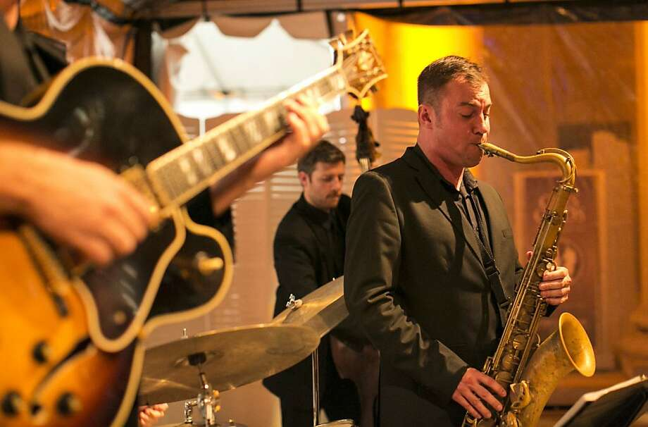 "Fil Lorenz (right) plays with the Fil Lorenz Quartet during a party to celebrate the film ""Citizen Hearst"" at the Legion of Honor in San Francisco, Calf., on Monday, October 15, 2012.  The documentary tells the story of the 125-year-old media company. Photo: Laura Morton, Special To The Chronicle"