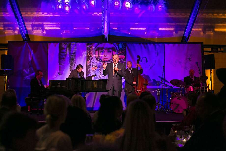 "Tony Bennett (center) sings at a party celebrating the film ""Citizen Hearst"" at the Legion of Honor in San Francisco, Calf., on Monday, October 15, 2012.  The documentary tells the story of the 125-year-old media company. Photo: Laura Morton, Special To The Chronicle"