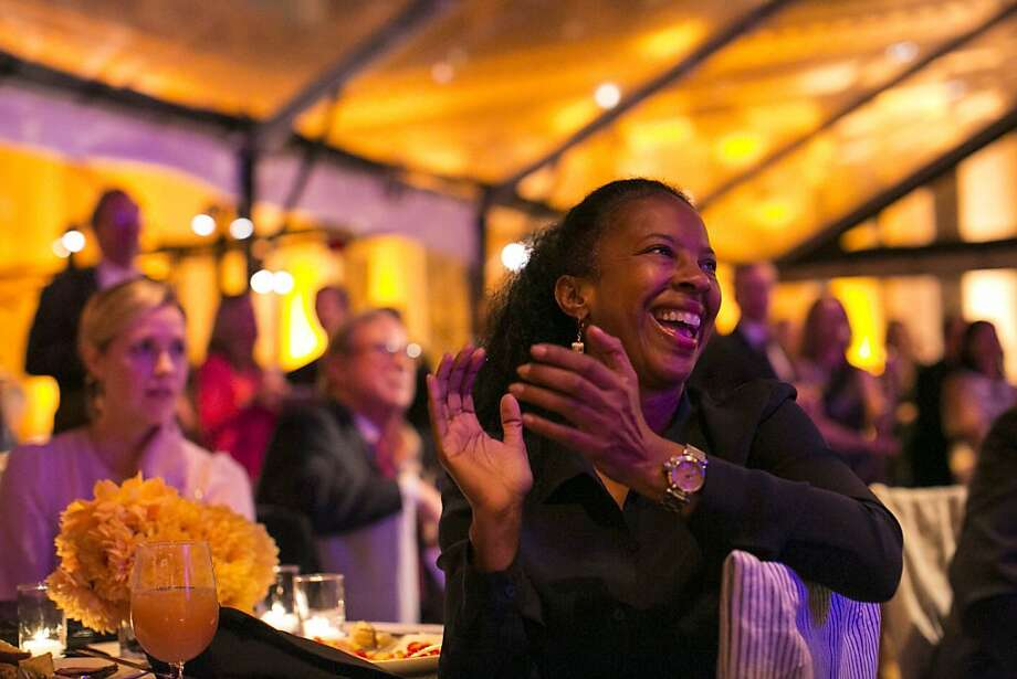 "Regina Jackson (right) claps for Tony Bennett during a party celebrating the film ""Citizen Hearst"" at the Legion of Honor in San Francisco, Calf., on Monday, October 15, 2012.  Guests were treated to a screening of the documentary, which was followed by Bennett's performance. Photo: Laura Morton, Special To The Chronicle"