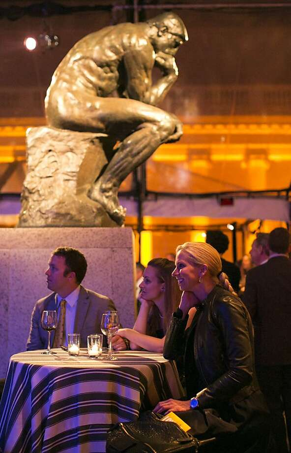 "Tim Brehmer, Laura Zolnoski and Tess Ruering (left to right) watch Tony Bennett sing during a party to celebrate the film ""Citizen Hearst"" at the Legion of Honor in San Francisco, Calf., on Monday, October 15, 2012.  Guests were treated to a screening of the documentary film, which was followed by Bennett's performance. Photo: Laura Morton, Special To The Chronicle"