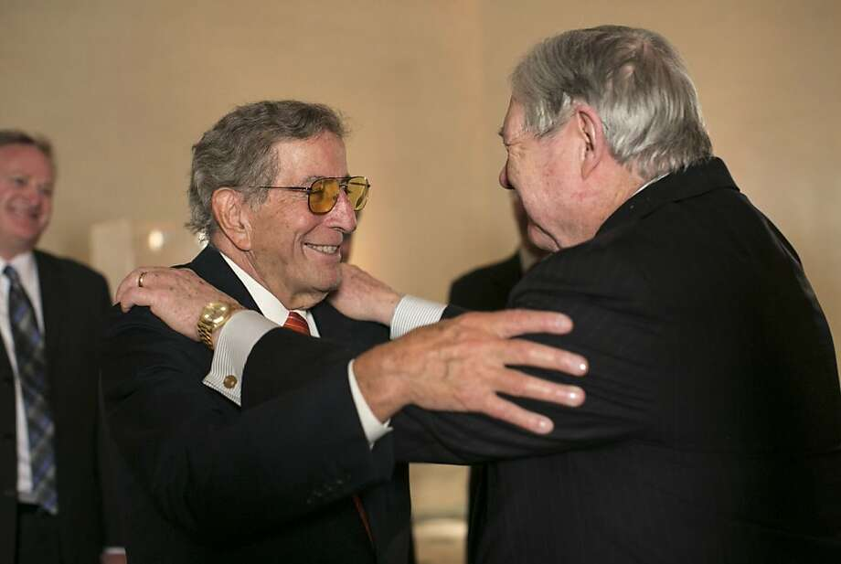 "Tony Bennett greets Hearst Corporation CEO Frank A. Bennack Jr. (right) after singing at a party to celebrate the film ""Citizen Hearst"" at the Legion of Honor in San Francisco, Calf., on Monday, October 15, 2012.  The documentary tells the story of the 125-year-old media company. Photo: Laura Morton, Special To The Chronicle"