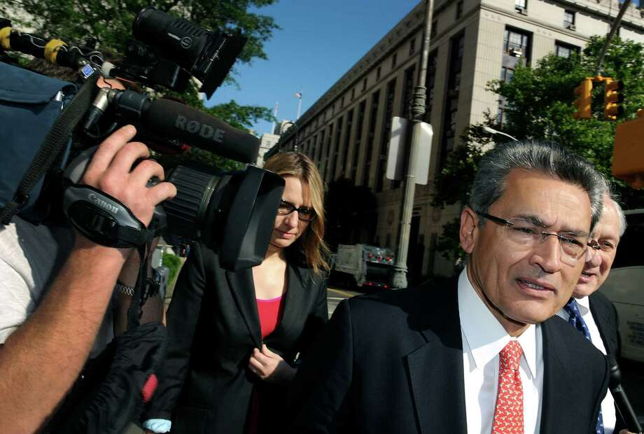 Rajat Gupta, center, a former Goldman Sachs Inc. director and senior partner at McKinsey & Co., arrives with his attorneys at federal court in New York, U.S., on Thursday, June 7, 2012. Microsoft Corp. Chairman Bill Gates was among supporters of Gupta who wrote letters urging mercy at his sentencing next week for his part in a hedge fund insider trading scheme. Photo: Peter Foley, Bloomberg / © 2012 Bloomberg Finance LP