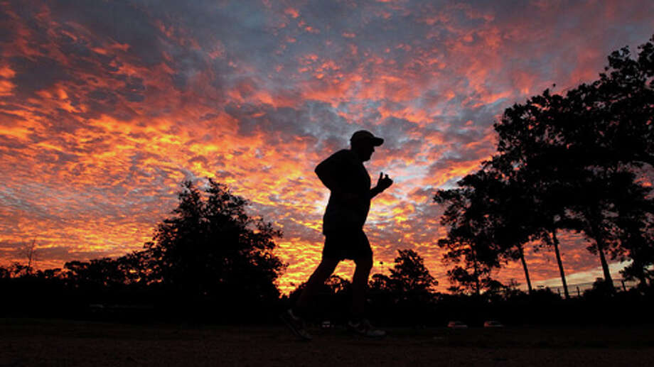 Fernando Trejo does his morning run through T.C. Jester Park at sunrise. Photo: .