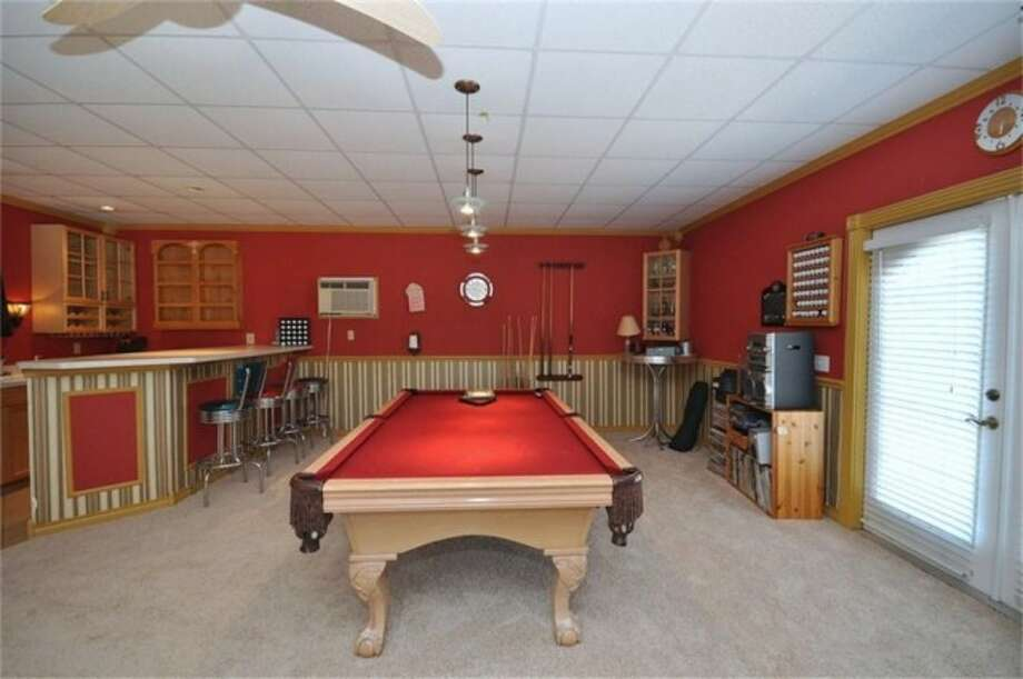 The game room has plenty of space for a pool table, ping pong table or other game set-up. Photo: Keller Williams
