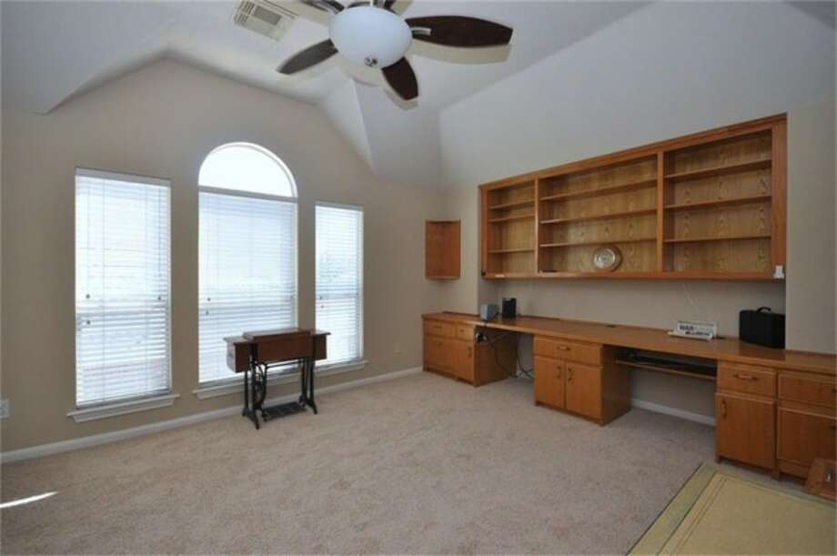 A large, carpeted study allows residents to set up their own home office or library. Photo: Keller Williams