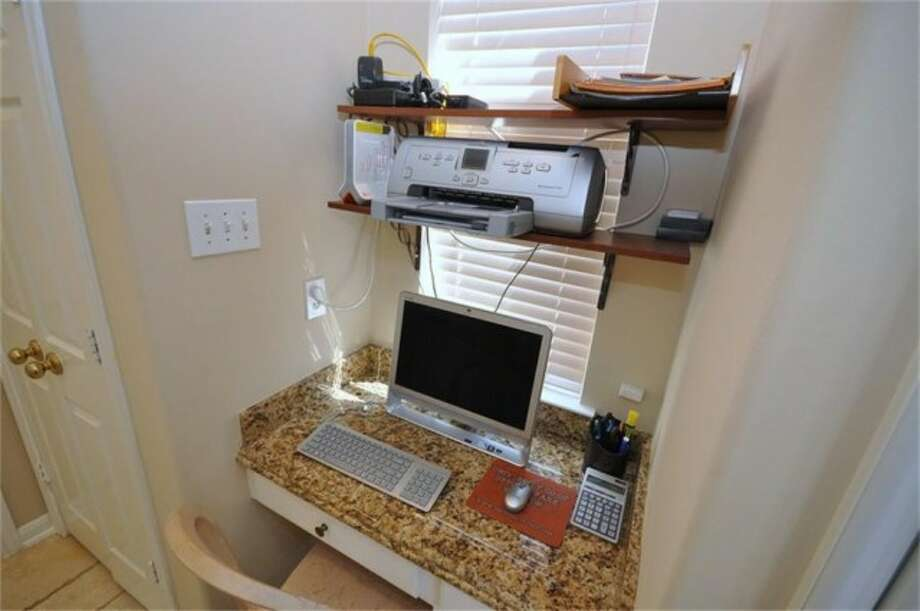 This cozy alcove has been utilized for a home computer set-up. Photo: Keller Williams