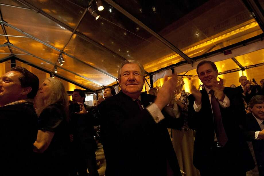 Hearst Corporation CEO, Frank A. Bannack, left, and COO, Steve Swartz, right, clap for Tony Bennett during a reception following the screening of Citizen Hearst, a new documentary about William Randolph Hearst, directed by Leslie Iwerks, at the Legion of Honor in San Francisco on Monday, October 15, 2012. Photo: Erin Lubin, Special To The Chronicle