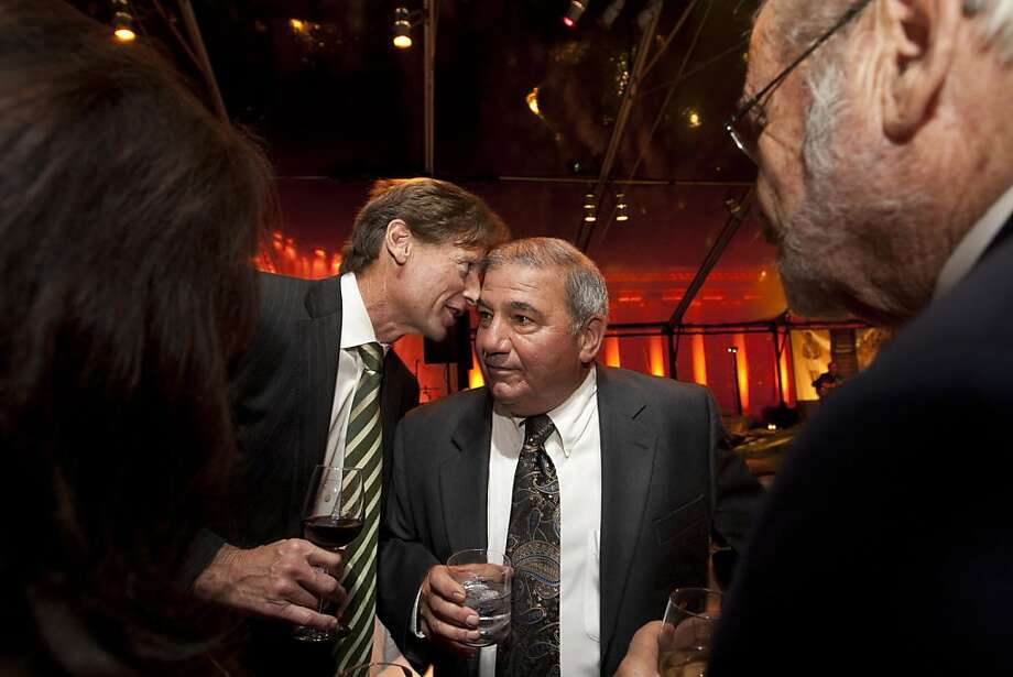 San Francisco Chronicle Editor, Ward Bushee, left, talks to Chronicle Publisher, Frank Vega, right, during a reception following the screening of Citizen Hearst, a new documentary about William Randolph Hearst, directed by Leslie Iwerks, at the Legion of Honor in San Francisco on Monday, October 15, 2012. Photo: Erin Lubin, Special To The Chronicle