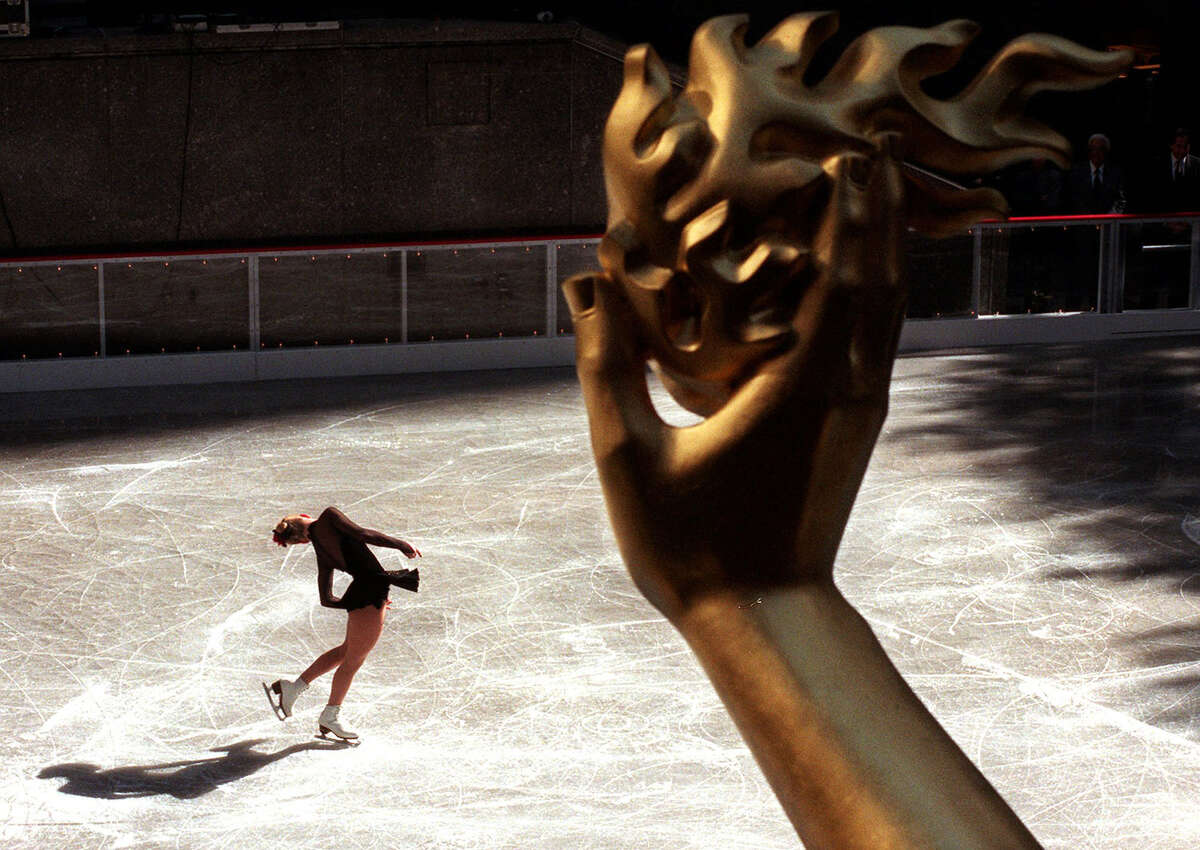 The outdoor skating rink at New York's Rockefeller Center has been open annually since 1936 and has been a symbol of winter in the city ever since. Here, Jessica Mills performs at the Rink at Rockefeller Plaza for the opening of the skating season Tuesday, Oct. 15, 1996.