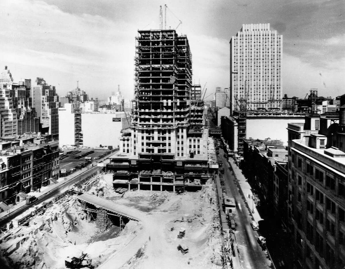 The construction site of the projected 70-story RCA Building at Rockefeller Center in New York is seen in this 1932 photo. The excavation site in front of the RCA Building is to become a public plaza hosting an ice skating rink.