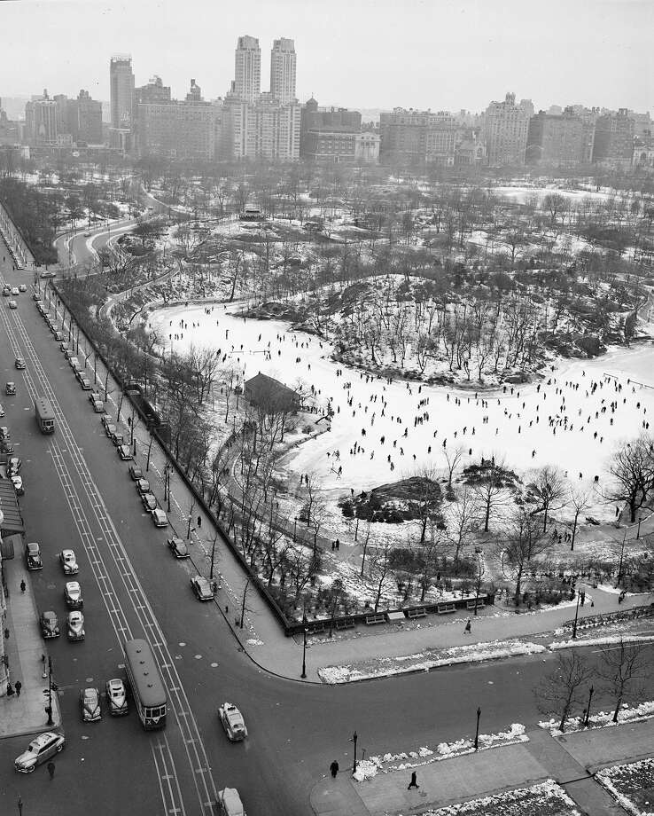 But outdoor skating has long been a favorite past time in New York.This aerial view from 59th St. and Fifth Ave., shows ice skaters in New York's Central Park. Photo: ASSOCIATED PRESS / AP1944