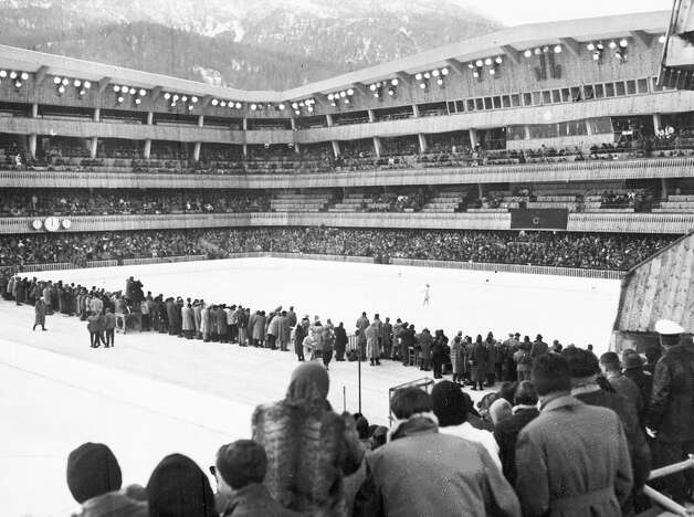 A view of the stadium at Cortina, Italy, during the women's figure skating event, in the seventh Winter Olympic Games, on Feb. 2, 1956. Carol Heiss of USA is on the ice, and she won the silver medal in the event. These games would be the last time that the figure skating competition would be held outdoors. (AP Photo) Photo: NOLDE, AP / 1956 AP