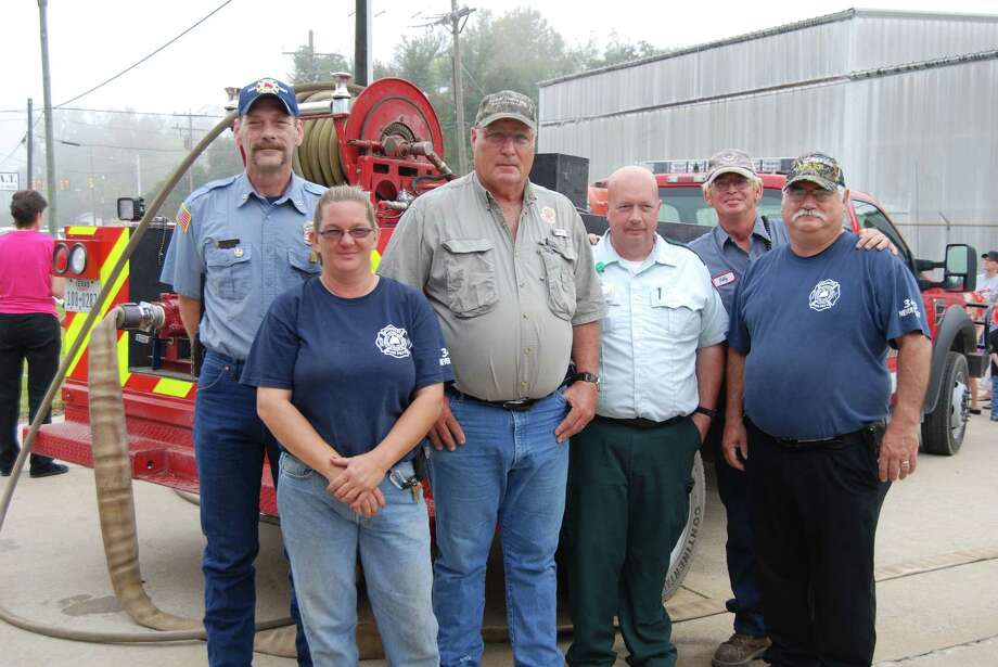 "L to R: Russell Tiedemann, Jennifer Reid, James ""Curly"" Johnson, Dean Troup, Billy Eakes, Billy Melancon. Now Curly is with Lumberton fire but was there with his grandson to help, and the Kountze team graciously excepted. Photo: Jay Cockrell / Jay Cockrell"