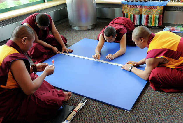 A group of Buddhist monks begin work on an intricate sand exhibit in the Student Center at the westside campus of Western Connecticut State University in Danbury Monday, Oct. 15, 2012. Photo: Carol Kaliff / The News-Times
