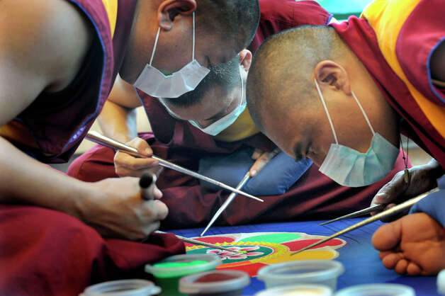 Tibetan Buddhist monks from the Drepung Gomang Monastary in India, create an intricate sand exhibit at Western Connecticut State University Monday, Oct. 15, 2012. Photo: Carol Kaliff / The News-Times