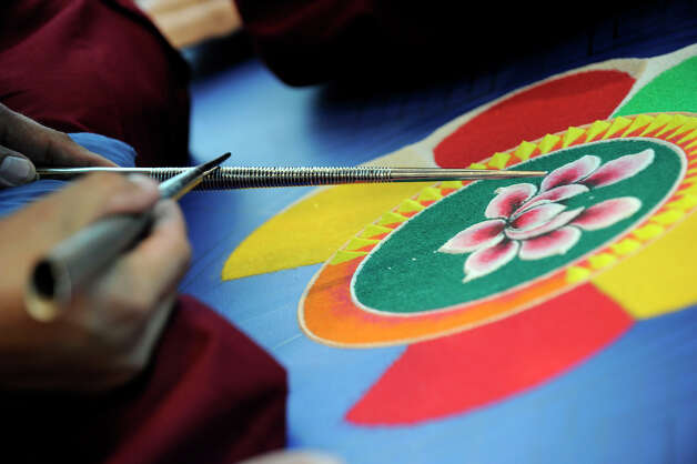 Using chukpur tubes, Buddhist monks create an intricate sand exhibit at Western Connecticut State university Monday, Oct. 15, 2012. Photo: Carol Kaliff / The News-Times