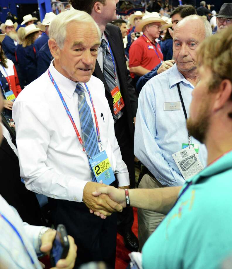 Rep. Ron Paul (R-TX/14) greets convention attendees at the second session of the 2012 Republican National Convention at the Tampa Bay Times Forum in Tampa, Tuesday, August 28, 2012. (Lionel Hahn/Abaca Press/MCT) Photo: Lionel Hahn, McClatchy-Tribune News Service / Harry E. Walker, Copyright 2012