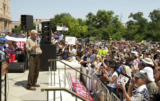 Ron Paul speaks at The Tea Party Express rally at the Capitol in Austin, on Sunday May 6, 2012.  Thousands attended the event, which included speeches by Paul and U.S. Senate candidate Ted Cruz. Photo: Jay Janner, Associated Press / Austin American-Statesman