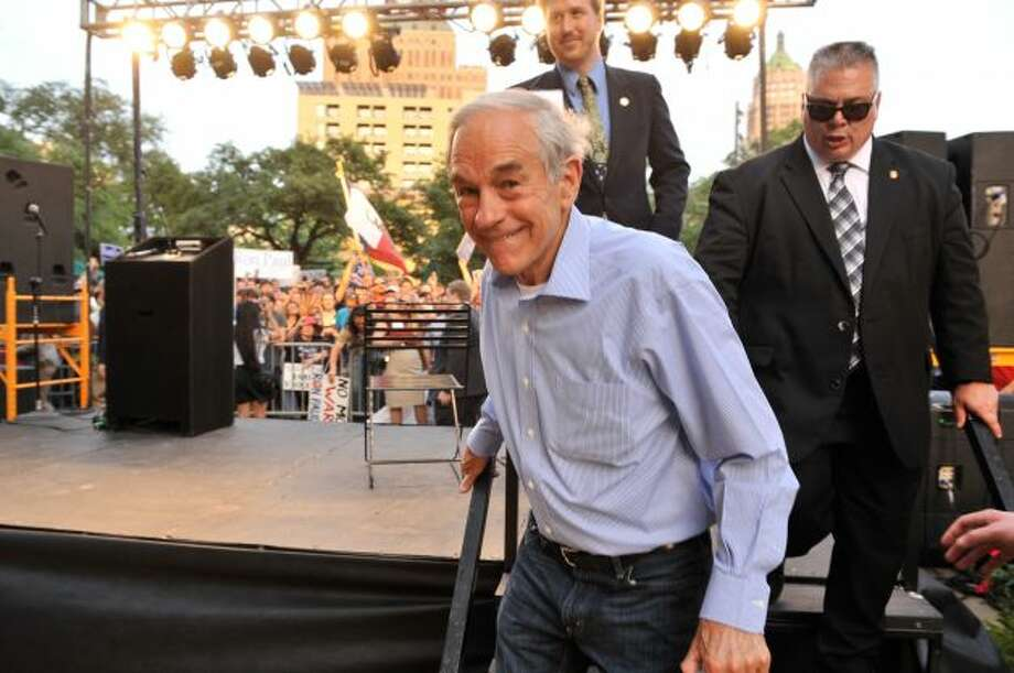 GOP presidential candidate Ron Paul leaves the stage after speaking to supporters at a rally in Main Plaza on Thursday, April 12, 2012.