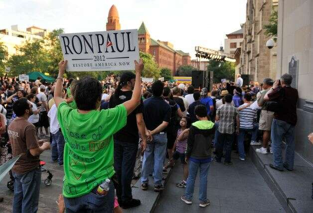 A man shows his support for Ron Paul as the GOP presidential hopeful speaks Thursday evening, April 12, 2012, at Main Plaza.
