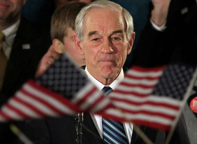Ron Paul speaks to supporters during a rally on the night of the Iowa caucus at the Courtyard Des Mo