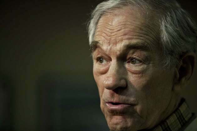 Ron Paul answers questions from the media after at the Greenville/Spartanburg Whistle Stop at the Greenville Downtown Airport on Jan. 20, 2012 in Greenville, S.C. Photo: John W. Adkisson, Getty Images / 2012 Getty Images