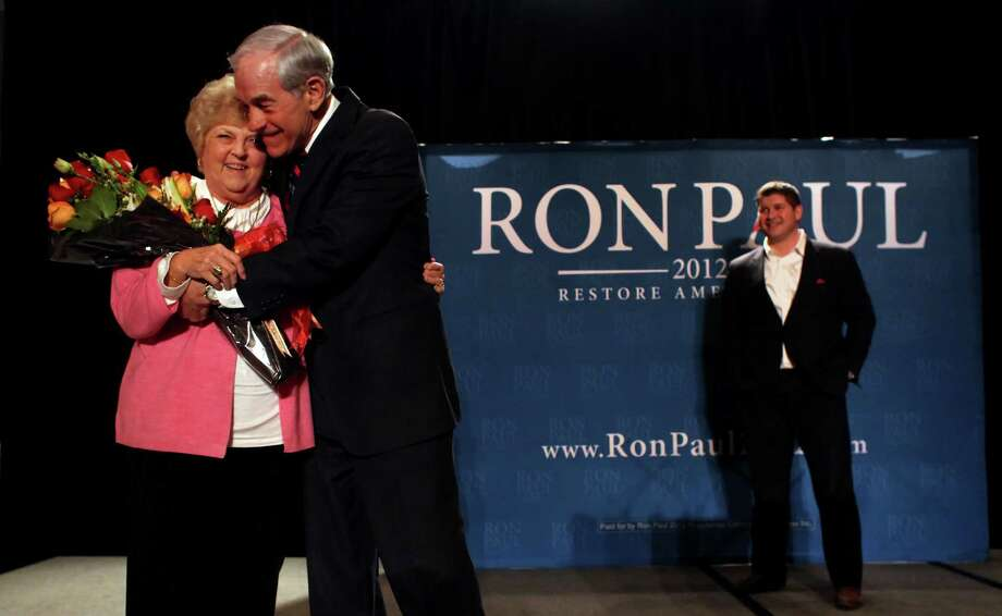 Ron Paul gives his wife Carol flowers for their 55th wedding anniversary at a rally to launch off his campaign for the Nevada caucus, Wednesday February 1, 2012, at the Four Season Hotel in Las Vegas, Nevada. Photo: Lacy Atkins, The Chronicle / ONLINE_YES