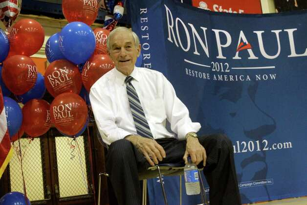 Republican presidential candidate Rep. Ron Paul, R-Texas, talks to supporters during a campaign rally Wednesday, March 14, 2012 in Champaign, Ill. (AP Photo/Seth Perlman) Photo: Seth Perlman, Associated Press / AP